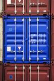 blå färgbehållare Arkivfoton