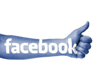 Blå facebooktum upp Arkivbild