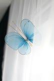 Blå fjäril på en vit bakgrund Fotografering för Bildbyråer