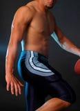 blå fotbollheismann poserar Arkivbild