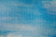 blå gjord självvattenfärg för abstrakt bakgrund Blå vattenfärg på texturerat papper Abstrakt textur och bakgrund för formgivare Arkivbild