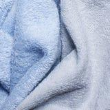 Blå grafit som är kall och, färgen av frottéhanddukar arkivfoto