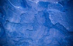 Blå granitbakgrund med karaktärsteckning geologiskt textur arkivfoto