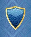 blå guld- sköld Arkivfoto