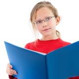 blå gullig flickaanteckningsbokstående Arkivfoton