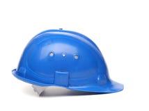 Blå hård hatt som isoleras på en vit bakgrund Arkivfoto
