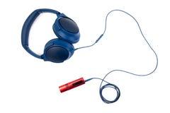 Blå Headphone med musikspelaren Arkivfoto
