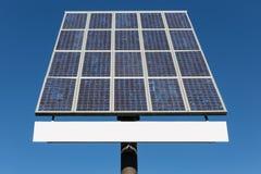 Blå himmel och solpanel med kopieringsutrymme för text Fotografering för Bildbyråer