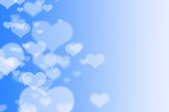 Blå hjärtabokeh som bakgrund Fotografering för Bildbyråer