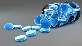 Blå huvudvärkstablettpreventivpillerar och flaska Arkivbilder