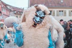 Blå jäkel med horn och vitt hår royaltyfri foto