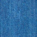 Blå jeanmodell som är sömlös för textur och bakgrund Royaltyfri Foto