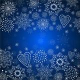 Blå julbakgrund med den vita snowflaken Royaltyfria Foton