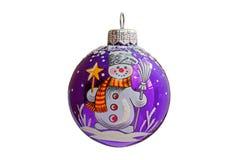 Blå julboll med snögubbetrycket Arkivfoto