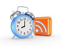 Blå klocka och symbol av RSS. Arkivfoton