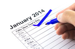 Blå kontroll. Fläck på kalendern på 1St Januari 2014, nytt år Royaltyfri Bild