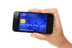 Blå kreditkort i telefon fotografering för bildbyråer
