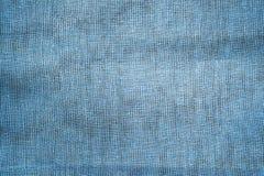 Blå lantlig gammal tygbakgrund Royaltyfria Bilder