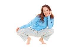 blå lycklig pyjamaskvinna arkivbild