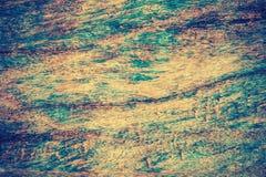 Blå målarfärg på brun wood bakgrund för tappningfärgabstarct Arkivfoto