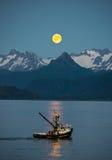 Blå måne från Homer, Alaska royaltyfria bilder