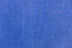 blå mörk jeanstextur Naturlig textilgrov bomullstvill Royaltyfri Bild