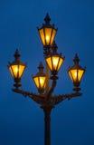 blå mörk lampa - orange Arkivfoto