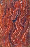 blå marmorerad paper röd tappning arkivfoto