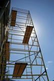 blå material till byggnadsställningsky för backgr Royaltyfria Foton