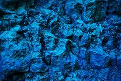 Blå metallisk bakgrund och textur av organisk stenyttersida Royaltyfria Foton