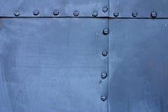 blå metallplatta Arkivfoto