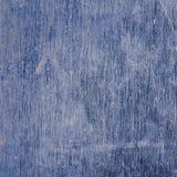 Blå metallyttersida med skrapor och fläckar Royaltyfria Bilder