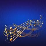 Blå musikalisk bakgrund med guld- anmärkningar och G-klav Royaltyfri Fotografi
