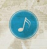 Blå musikanmärkning på grungepapper Arkivfoto