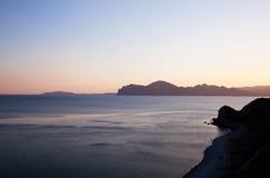 Blå och gul solnedgång Arkivbild