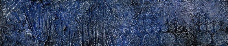 Blå och guld- präglad murbrukbakgrund royaltyfri foto