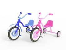 Blå och rosa trehjuling Arkivfoto