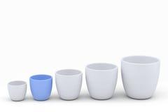 Blå och vit keramikblomkrukauppsättning, framförda modeller Arkivbild