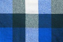 blå pläd Arkivfoto