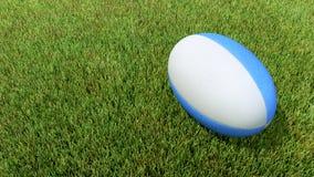 Blå rugbyboll på gräs V01 Royaltyfria Bilder