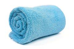 blå rullande handduk för strand upp Arkivbild