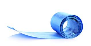 blå rulltextil Arkivfoto