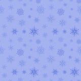 Blå sömlös bakgrund av snöflingor Arkivfoto