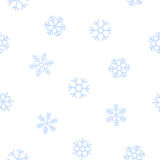 Blå sömlös bakgrund av snöflingor Royaltyfria Bilder