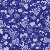 Blå sömlös modell med hjärtor Royaltyfria Bilder