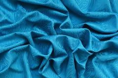 Blå siden- damast med krabb textur royaltyfria foton