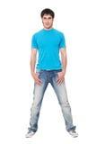 blå smiley t för grabbjeansskjorta royaltyfria bilder