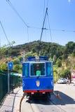 Blå spårvagn för nostalgiker till Tibidabo Invigt in 1901, använder fortfarande de samma spårvagnarna, vara således en av royaltyfri bild