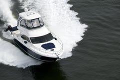 blå speedboatwhite royaltyfri bild