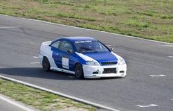 blå sportcar white Royaltyfri Fotografi